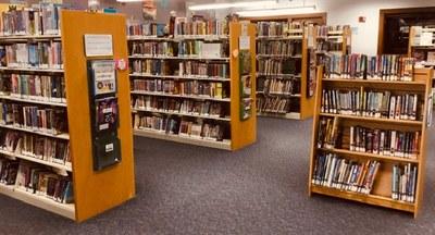Several book shelves inside the library