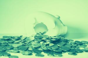 Open piggy bank and spilled coins